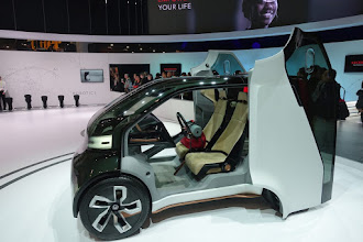 Photo: Honda's concept is a bit more realistic, a small and comfortable two seater.   With funky doors.