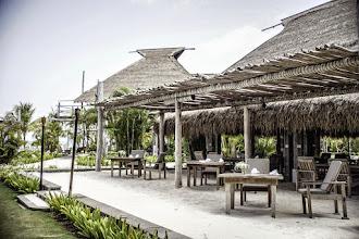 Photo: Alfresco dining area with sand floors