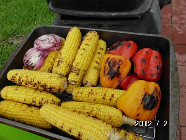 Grill till slightly charred.  Remove corn from cobs.  Remove skin from Anaheim...