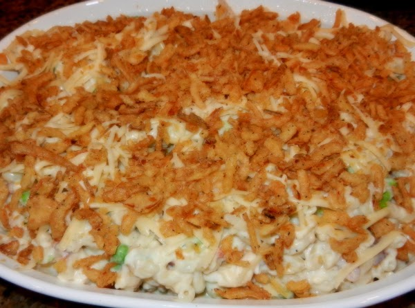 Pour into the baking dish, then sprinkle with the reserved shredded cheese and garlic...