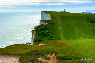 "Photo: The Lighthouse on the Top of the Cliff of Beach Head - Eastbourne, U.K.  The cliff of Beachy Head is the highest chalk sea cliff in Britain, rising to 162 meters or 530 ft. above sea level. The peak allows views of the southeast coast from Dungeness to the east, to Selsey Bill in the west. Its height has also made it one of the most notorious suicide spots in the world. Beachy Head also a popular setting for music videos , TV shows and movies, and can be seen in ""Harry Potter and the Goblet of Fire"" and James Bond's ""The Living Daylights"".  #BeachyHead   #SevenSisters   #Eastbourne   #England   #UK   © Yen Baet - www.YenBaet.com. All Rights Reserved. Join me on Facebook at www.facebook.com/YenBaetPhotography."
