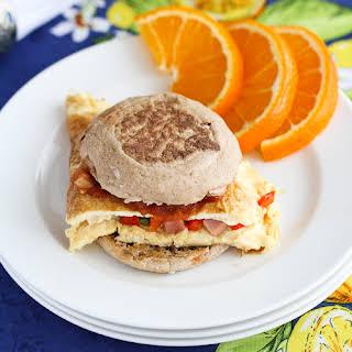 Western Omelet Breakfast Sandwich with Ham, Peppers & Salsa.