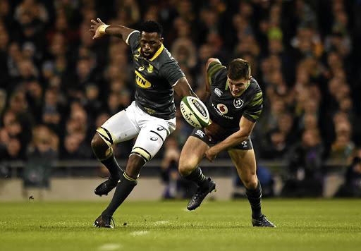 Springbok flanker Siya Kolisi tries to find a way past Ireland's Jacob Stockdale in Saturday's test match in Dublin .