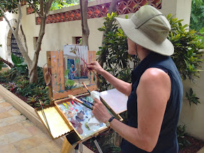 Photo: Chris Kling at work / painting fellow artist Manny J. at work.