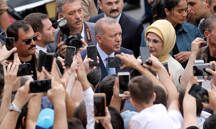 Turkish President Recep Tayyip Erdogan and his wife, Emine, leave a polling station in Istanbul, Turkey, June 24 2018. Picture: REUTERS