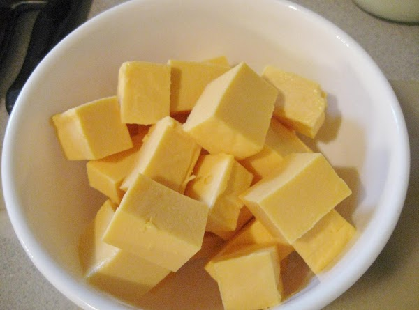 When hot and bubbly add the cheeses. Reduce heat to low and stir to...
