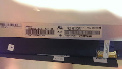 Photo: Tag for the LCD panel itself. INNOLUX N116BGE -EA2 Brightness is 220 cd/m^2 (source: http://www.panelook.com/N116BGE-EA2_Innolux_11.6_LCM_overview_21066.html)