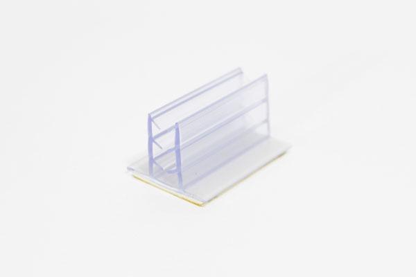 pinza plástica sujeta gráficas de 2,5 x 1,8 cm con adhesivo espumoso
