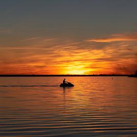 sunset jet ski by Burdell Edwin - Landscapes Sunsets & Sunrises ( pond, ocean, sunset, fishing, jet ski, jer ski, lake, water,  )