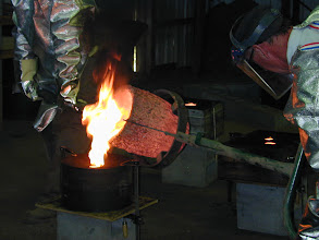 Photo: The left over material is poured into ingots to be re-melted at a future pour.