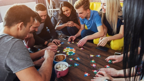 A group of friends playing a board game