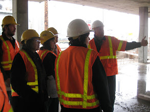 Photo: Brian Sweeney of the Housing Development Center leads the tour.