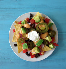 Photo: Low Calorie Nachos - A traditional Mexican side dish made with homemade tortilla chips and topped with cheese, black beans, tomatoes and onions.  http://www.peanutbutterandpeppers.com/2013/04/05/healthy-nachos/  #nachos   #mexicanrecipes   #healthynachos   #lowcalorienachos   #quesocheese   #nachocheese   #traderjoesquesocheese