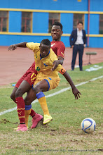 Photo: Haruna NIYONZIMA (8, Capt) moves past Baba Rahman (17) [Rwanda Vs Ghana AFCON2017 Qualifier, 5 Sep 2015 in Kigali, Rwanda.  Photo © Darren McKinstry 2015