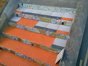 Photo: Detail of first flight of steps (from top) of the Hidden Garden Steps (16th Avenue, between Kirkham and Lawton streets in San Francisco's Inner Sunset District) as KZ Tile workers begin installing tread tiles on October 30, 2013 while continuing with installation of the 148-step ceramic-tile mosaic designed and created by project artists Aileen Barr and Colette Crutcher. For more information about this volunteer-driven community-based project supported by the San Francisco Parks Alliance, the San Francisco Department of Public Works Street Parks Program, and hundreds of individual donors, please visit our website at http://hiddengardensteps.org.