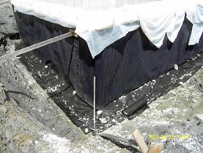 "Photo: ... vertical Platon seam sealed, drainage remediated: stone 4"" up the Platon & new fabric layed down ..."