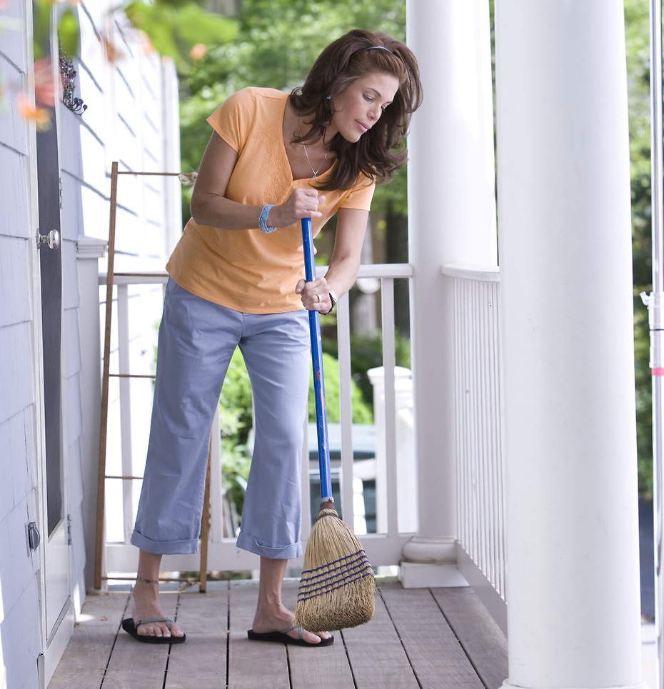 17107-a-woman-sweeping-her-front-porch-pv.jpg