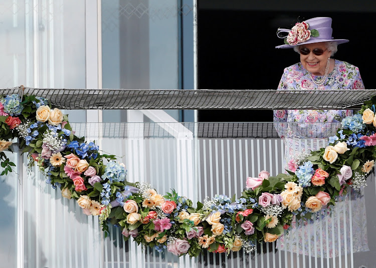 Queen Elizabeth II acknowledges the crowd during Derby Festival at Epsom, England, on Saturday.