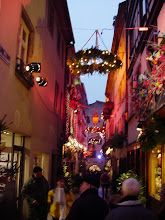 Photo: This narrow street is decorated with horizontal lit wreaths.