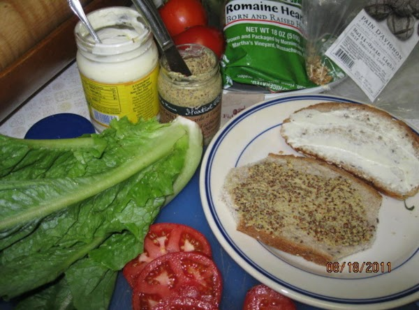 Spread the mustard on one side of one slice of bread; and spread the...