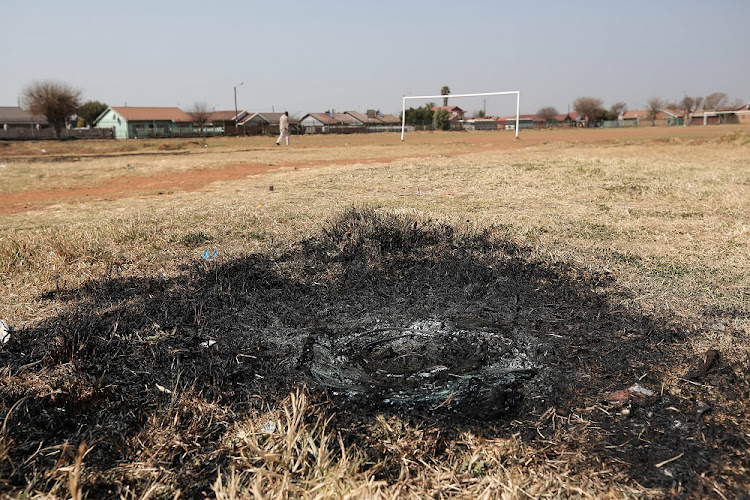 The scene where Siyanda Mjoli was necklaced in Daveyton, East of Johannesburg. A mob attacked and burned Mjoli with a tyre after being accused of being involved in gang related activity in the area.