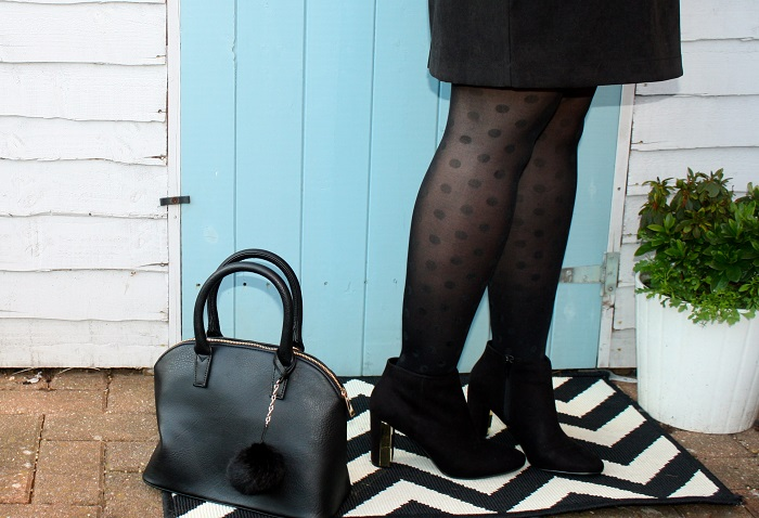 Black pom pom handbag and black boots