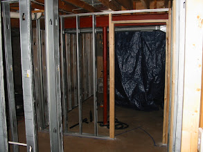 Photo: Hallway looking to laundry room with theater to the left.