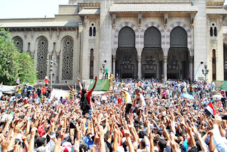 Photo: Thousands of Egyptians gather outside Al Fat'h Mosque for Friday's 'Day of Rage' protests following the recent brutal police and military crackdown on two pro Morsi sit ins that left over 500 people dead. Clashes between police and protesters broke out shortly after the noon prayer, leading to at least 95 people being killed. Cairo, EGYPT - 16/8/2013. Credit: Ali Mustafa/SIPA Press