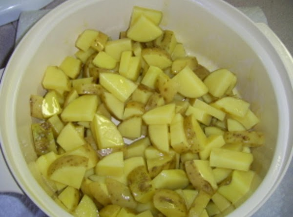 Spray a micro-wave safe dish and add potatoes. Spray potatoes lightly and mix to...