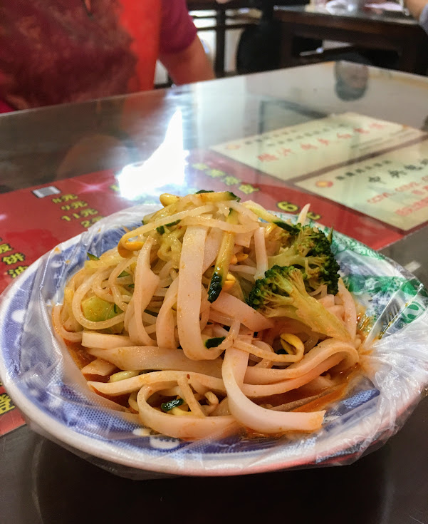 Thick, hand cut noodles with peanut and vinegar sauce. Served at room temperature. Much tastier than it looks.