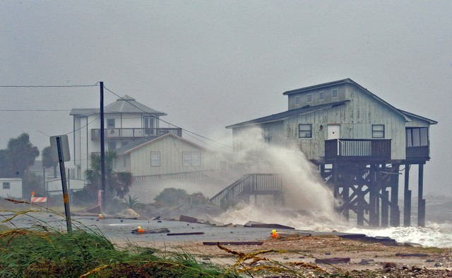 Waves crash on stilt houses along the shore due to Hurricane Michael at Alligator Point in Franklin County, Florida, US, October 10, 2018.