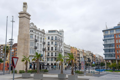 Classic buildings frame a public square in Valencia, Spain.
