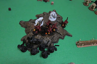 Photo: Turn 4 - end of Dark Angel turn - Another Terminator has fallen, but the Dark Angel Chaplain is unable to cause any wounds to the Archon, thanks to the Dark Eldar's Ghostplate Armor. The Assault Marines seize their chance to assault, while the second squad of Terminators is moving in!