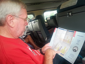 Photo: Checking the timetable. We were running pretty late into Albany. Between the brake