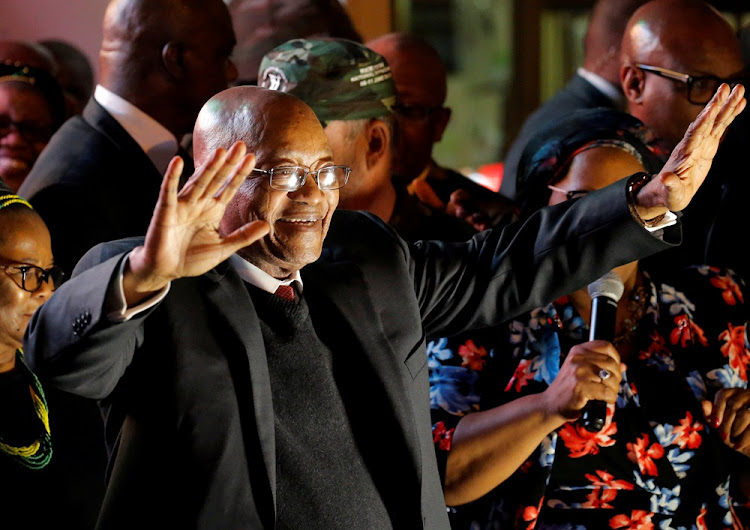 President Jacob Zuma celebrates with his supporters after he survived a no-confidence motion in parliament in Cape Town, South Africa, August 8, 2017.