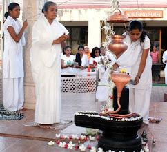 Photo: Girls performing sandhyakaal pooja in presence of Bramhacharini Varshaben