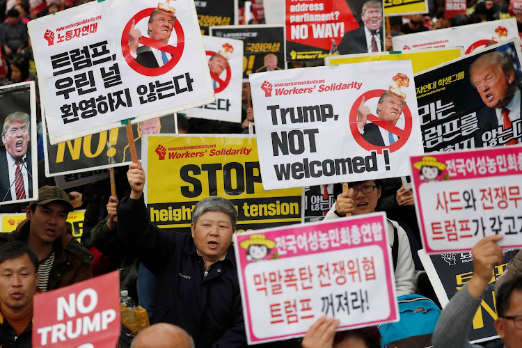 People take part in an anti-Trump protest near the Presidential Blue House in Seoul, South Korea. REUTERS/Kim Hong-Ji