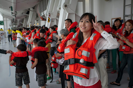 costa-victoria-muster-drill.jpg - Passengers gather for a safety drill (muster drill) aboard Costa Victoria.
