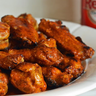 Grilled Chicken Wings with Seasoned Buffalo Sauce.