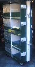 Photo: Lateral view of one complete nursery unit existing of 4 on top compartments and having the electric devices installed on the right side.
