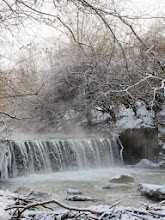 Photo: Waterfall with mist rising from it under the snow at Eastwood Park in Dayton, Ohio.