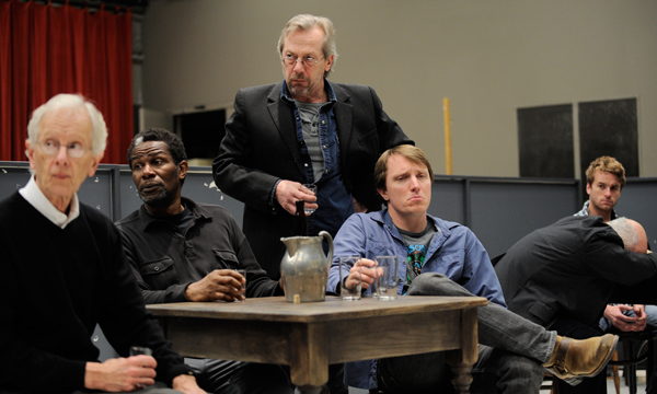 Photo: (Left to right) Jimmy Tomorrow (James Harms), Joe Mott (John Douglas Thompson), Harry Hope (Stephen Ouimette), Willie Oban (John Hoogenakker), and Don Parritt (Patrick Andrews) look off during a rehearsal of Eugene O'Neill's The Iceman Cometh, directed by Robert Falls, at Goodman Theatre (April 21 – June 17).