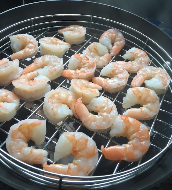Steam shrimp until it is pink and opaque. Flip after a couple of minutes....