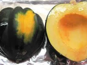 Slice Acorn Squash into half (top to bottom) remove seeds, ( can save seeds...