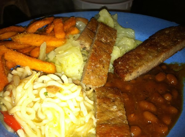 Pasta noodles with onion, bell pepper, basil, garlic powder and a little chicken broth and butter Sweet potato fries, Pork sausage strips, Baked beans, fried cabbage!