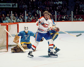 Photo: MONTREAL, CANADA- CIRCA 1978: Ed Staniowski #31 of the St. Louis Blues attempts to locate the puck through a screen by Bob Gainey #23 of the Montreal Canadiens Circa 1978 at the Montreal Forum in Montreal, Quebec, Canada. (Photo by Denis Brodeur/NHLI via Getty Images)