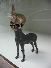Photo: weird dog/skull art in a gallery windiw