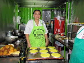 "Photo: And this might just be heaven on a grill. Su Casa Colombia guide Noah's absolute favorite food in Colombia is the ""arepa de chocolo"". Imagine moist corn bread that's lightly cooked on both sides like a pancake, then top it with a little butter and two thick slices of cheese. Delicious."