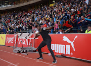 Retired Jamaican athletic superstar Usain Bolt meets fans during the PUMA School of Speed competition at Ruimsig Stadium on January 29, 2018 in Johannesburg, South Africa.