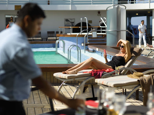 An attendant and passenger on the Pool Deck of Silver Whisper.